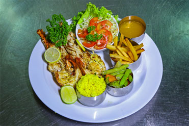 Grilled Lobster with salad, French fries and more