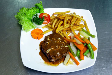 Grilled Minute Steak with black paper sauce, boiled vegetables and more