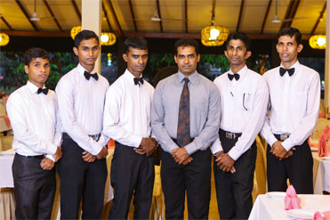 Serving staff at Golden Grill Bentota